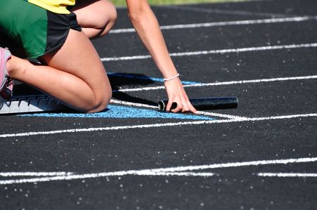 Teen Girl in the Starting Blocks at a Track Meet photo