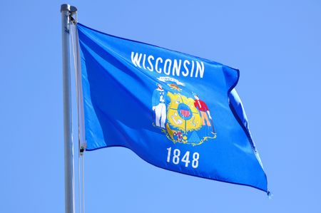 wisconsin state: Wisconsin State Flag Against a Blue SKy Stock Photo