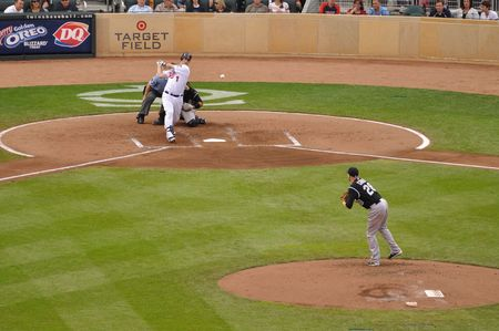 mn: MINNEAPOLIS, MN - JUNE 15: 2009 AL MVP Joe Mauer of the Minnesota Twins hits a pitch from Colorado Rockies pitcher Aaron Cook on June 15, 2010 in Minneapolis, MN