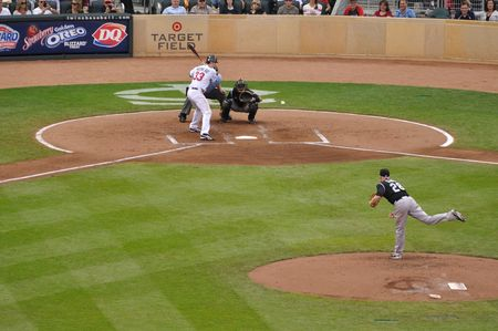 MINNEAPOLIS, MN - JUNE 15: 2006 AL MVP Justin Morneau of the Minnesota Twins batting against Colorado Rockies pitcher Aaron Cook on June 15, 2010 in Minneapolis, MN