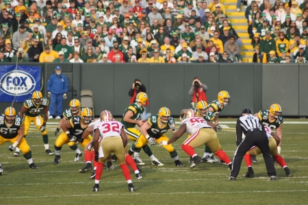 GREEN BAY, WI - NOVEMBER 22 : Green Bay Packers quarterback Aaron Rodgers takes the snap in a game at Lambeau Field against the San Francisco 49ers on November 22, 2009 in Green Bay, WI Stock Photo - 7223626