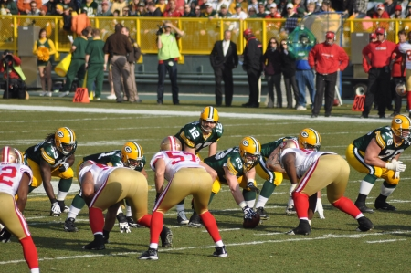 GREEN BAY, WI - NOVEMBER 22 : Green Bay Packers quarterback Aaron Rodgers prepares to take the snap in a game at Lambeau Field against the San Francisco 49ers on November 22, 2009 in Green Bay, WI Editorial