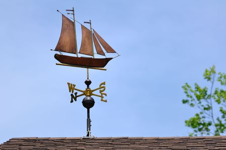 Sailboat (Schooner) Weather Vane on a Roof photo