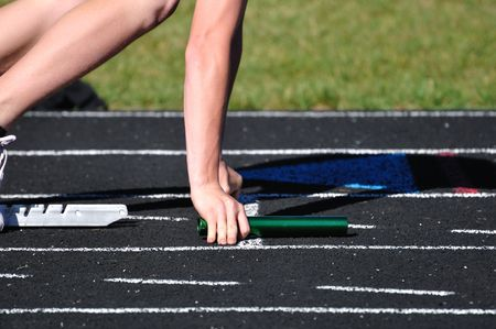 Teen Boy in the Starting Blocks at a Track Meet photo