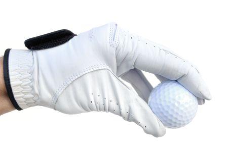 ゴルファーのゴルフ ・ ボールを保持しているゴルフ グローブを身に着けています。
