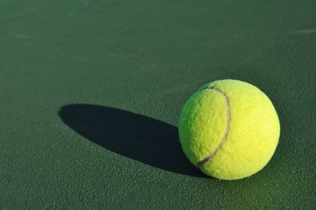 shadow: Yellow Tennis Ball on Green Tennis Court