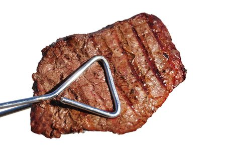 Tongs Holding Grilled Beef Loin Top Sirloin Steak Isolated on White Фото со стока