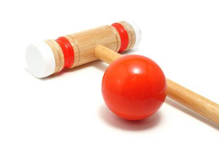 オレンジ クロケット マレットでボール白で隔離されます。 写真素材