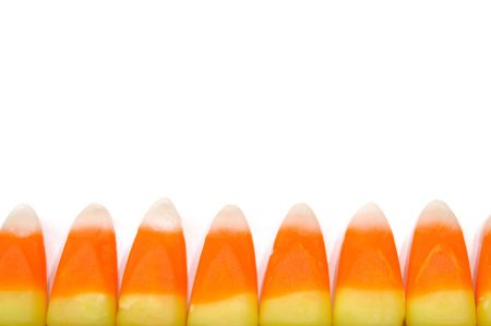 Row of Candy Corn for a Border Isolated on White Stock Photo - 7542518