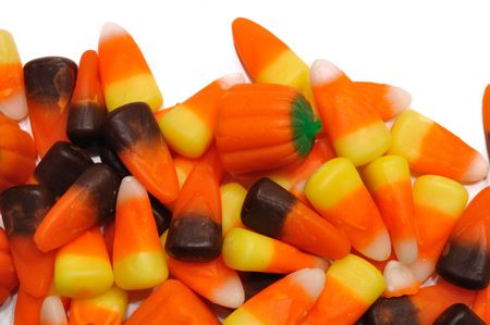 Halloween Candy Corn and Pumpkins Isolated on White photo
