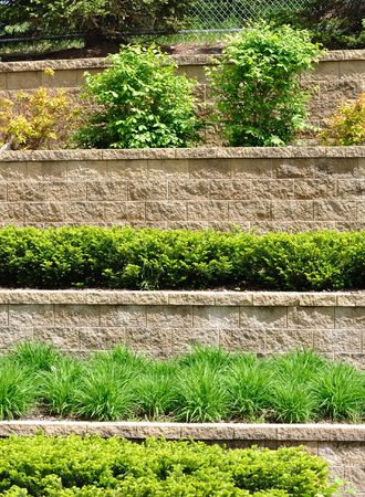 retaining: Tiered Retaining Wall with Plants and Shrubs