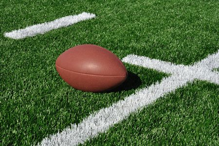 yardline: Football near Hash Marks on Artificial Turf