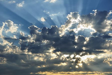 Sunbeams Through the Clouds with a Blue Sky