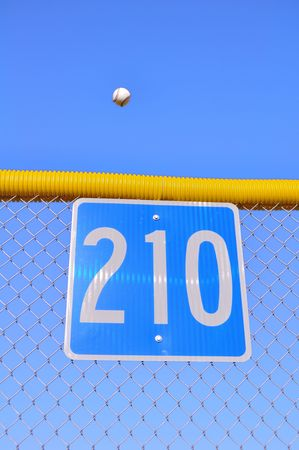 Baseball Flying Over the Fence For a Home Run Stock Photo - 7592674