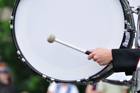 bass drum: Drummer Playing A Bass Drum in Parade