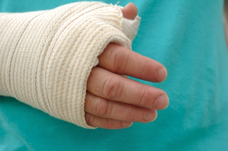 arm: Injured Hand and Arm Wrapped in an Elastic Bandage Stock Photo