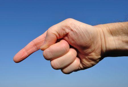 青い空を背景にダウンを指している手 写真素材