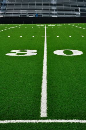 yardline: 30 Yard Line on American Football Field with Bleachers Stock Photo