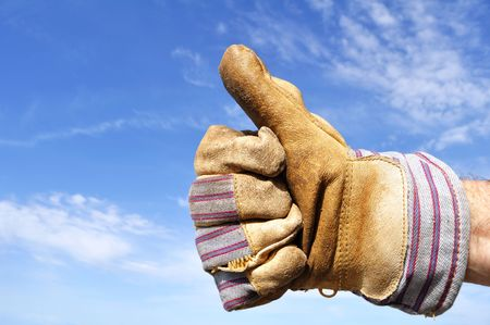 Worker Wearing Leather Work Glove Giving the Thumbs Up Sign Stock Photo - 7718607