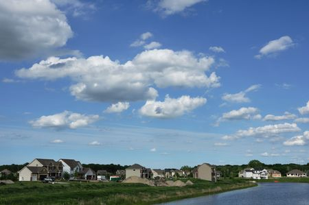 Suburban Executive Homes by Lake and New Construction Stock Photo - 7782997
