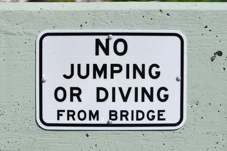 disallowed: No Jumping or Diving From Bridge Sign Stock Photo