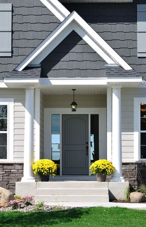 porch: Front Entrance of a Residential House with Yellow Chrysanthemum Flowers on Porch