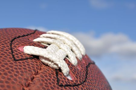 american football background: Close-up of American Football Texture and Laces with Selective Focus Stock Photo