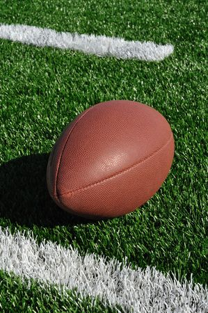 hash: Football near Hash Marks on Artificial Turf
