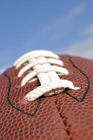Close-up of American Football Texture and Laces with Selective Focus photo