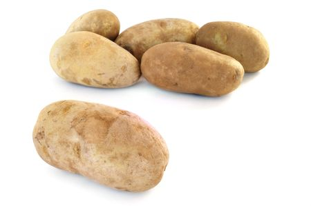 russet: Six Raw Russet Potatoes Isolated on White