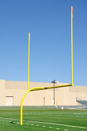 Yellow Goal Posts on American Football Field Stock Photo - 8098492