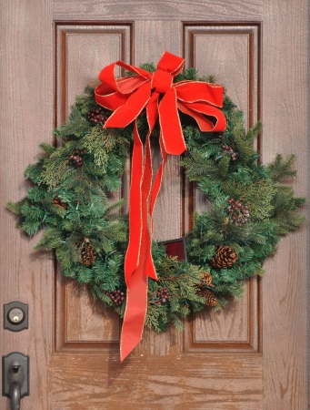Christmas Wreath with Red Bow on a Door photo