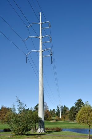 power lines: Power Lines Against a Clear Blue Sky Stock Photo