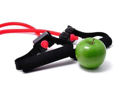 stretchy: Resistance Band and Green Apple isolated on a white background