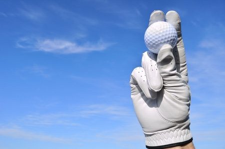 grasp: Golfer Wearing Golf Glove Holding a Golf Ball