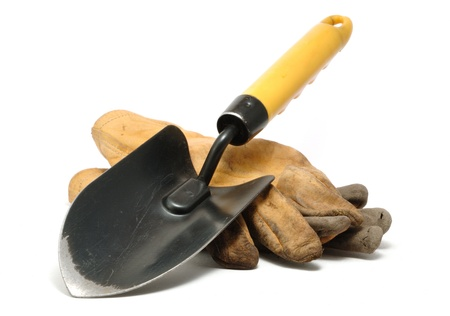 spade: Old Dirty Leather Work Gloves and Trowel Isolated On White Stock Photo