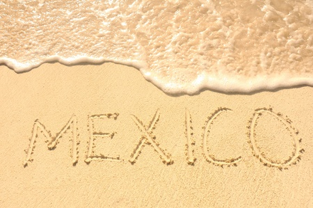 roo: The Word Mexico Written in the Sand on a Beach