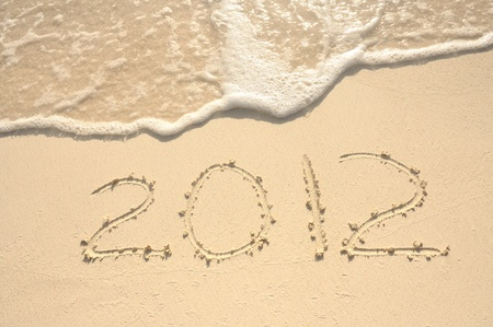 The Year 2012 Written in the Sand on a Beach Stock Photo