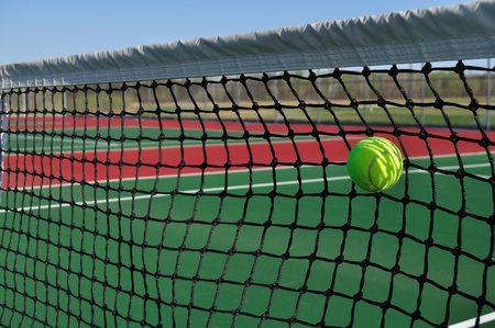 A Service Fault, Yellow Tennis Ball Hitting the Net Stock Photo