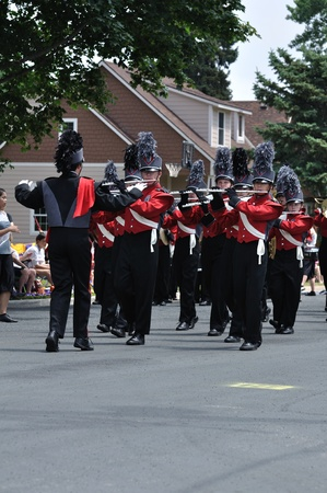 OSSEO, MN - JUNE 26 : Richfield High School Marching Band Performing in the Osseo Marching Band Festival on June 26, 2010 in Osseo, MN Stock Photo - 9465983