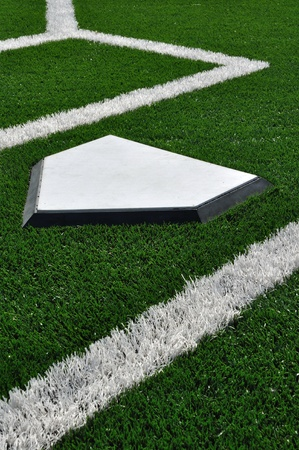 Home Plate on Baseball Field with Artificial Turf