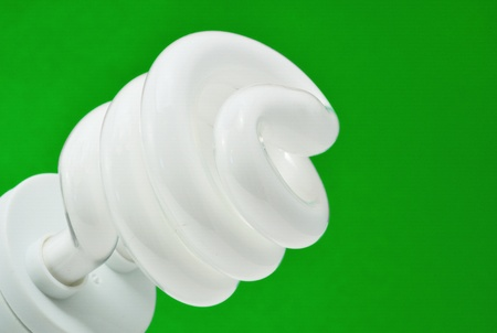 compact fluorescent light (CFL) with green background photo