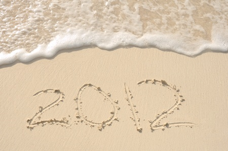 The Year 2012 Written in the Sand on a Beach Stock Photo - 9522517