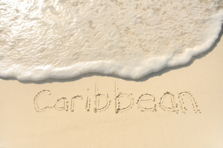 word: The Word Caribbean Written in the Sand on a Beach