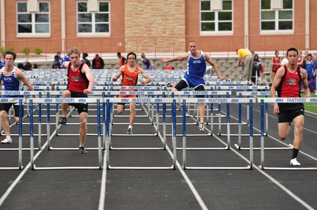 SPRING LAKE PARK, MN - May 7: Unidentified Teen Boys Competing in High School Hurdles Race on May 7, 2010 in Spring Lake Park, Minnesota.