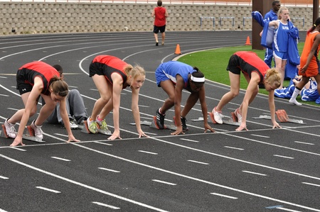 SPRING LAKE PARK, MN - May 7: Unidentified Teen Girls in the Starting Blocks at a High School Sprint Race on May 7, 2010 in Spring Lake Park, Minnesota. 報道画像