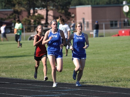 NORTH BRANCH, MN - May 27: Unidentified Teen Girls Competing in Long Distance High School Track Meet Race on May 27, 2010 in North Branch, Minnesota.