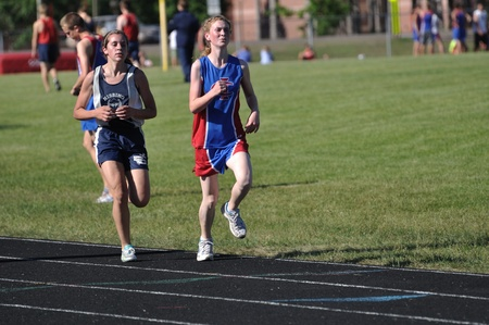 NORTH BRANCH, MN - May 27: Unidentified Teen Girls Competing in Long Distance High School Track Meet Race on May 27, 2010 in North Branch, Minnesota. Stock Photo - 9561587