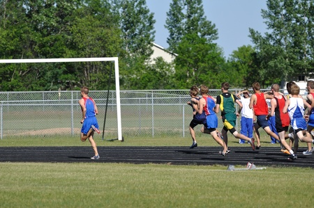 NORTH BRANCH, MN - May 27: Unidentified Teen Boys Running in a Long Distance High School Track Meet Race on May 27, 2010 in North Branch, Minnesota.