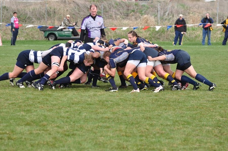 BLAINE, MN - APRIL 30: A scrum in a women's collegiate rugby match between Navy and the Brigham Young University (BYU) Cougars in the NCAA Division I College Championship quarterfinals on April 30, 2011 in Blaine, MN Stock Photo - 9654792